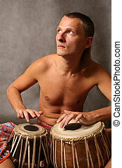 Drummer - Man playing the nigerian drum in studio
