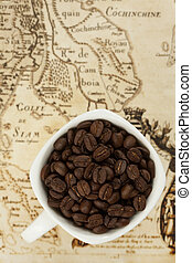 Coffee beans in a cup on siam map background