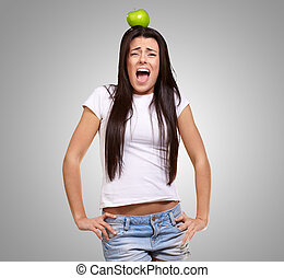 Young Girl With Apple On Head Isolated On Grey Background