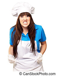 portrait of a female chef clenching