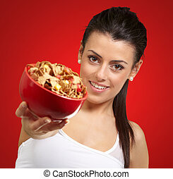 Young woman holding a cereal bowl