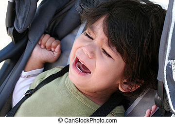 Toddler crying in stroller - Unhappy toddler crying in...