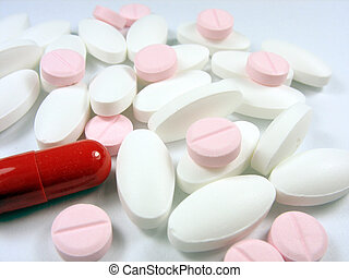 close up of pharmaceutical different color medical drugs