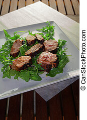 Pork tenderloin medallions - Sliced pork tenderloin with...