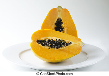 Pawpaw or Papaya isolated on a white plate - Papaya or...