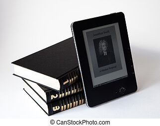 three books with electronic reader