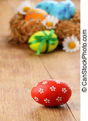 Easter eggs in the nest - Nest with Easter eggs on the...