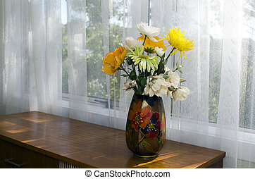 Yellow and White Flowers in a Vase - A vase full of white...