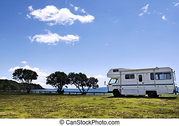 Camper van in a camp ground near the sea in a sunny summer...