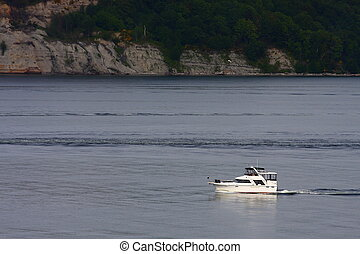White Cabin Cruiser in Calm Sea - A nice white cabin cruiser...