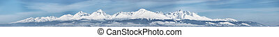Snow capped summit of Tatry high under clear blue panoramic...
