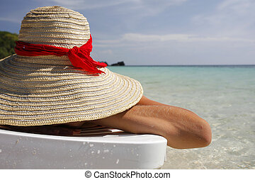 Woman on the beach - Pretty woman lying on the beach in a...