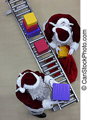 santa clauses at production line - Overhead view of two...
