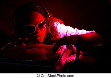 cool afro american DJ in action under red light