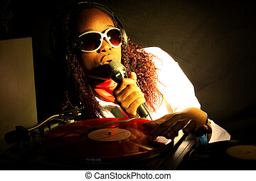 cool afro american DJ in action under yellow-red light