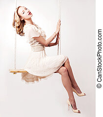 woman on a swing - beautiful young blond woman on a swing...