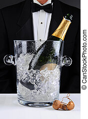 Waiter Standing Behind a Champagne Bucket - Closeup of a...