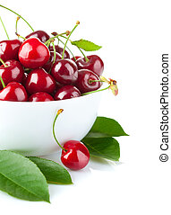 fresh cherry berries with green leaf