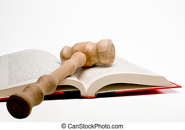 Law Book and Gavel - An open law book and a judges gavel