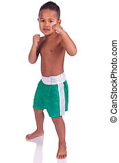 Mixed martial artists children - asian boy children before a...