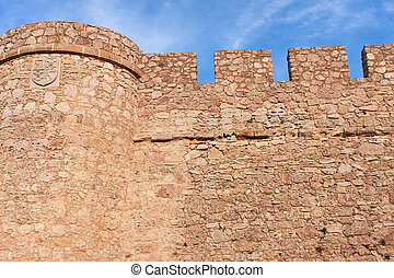 the wall - castle wall of chinchilla castle, in albacete...