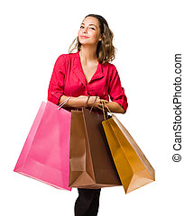 Happy shopper. - Cool friendly young brunette woman holding...