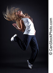 woman modern dancer against black background - woman modern...