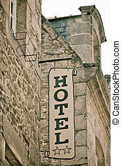 Hotel Sign on Old Stone Building in France Toned image