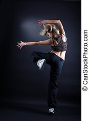 woman modern dancer against black background