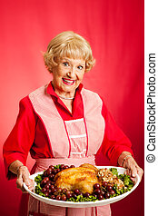 Retro Housewife Cooks Holiday Meal - Sweet retro grandmother...