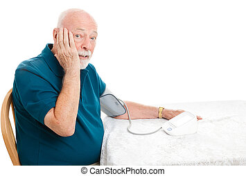 Senior Surprised by Blood Pressure - Senior man taking his...