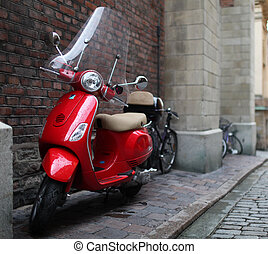 Vespa a scooter - the red a vintage Vespa a scooter