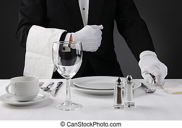 Waiter Setting Formal Dinner Table - Closeup of a waiter in...