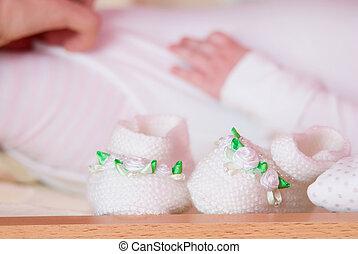 Knitted socks against child.