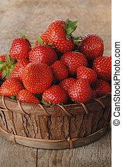 Basket of strawberries - Basket of fresh strawberries on...