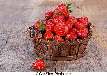 Basket of strawberries - Basket of fresh strawberries on...