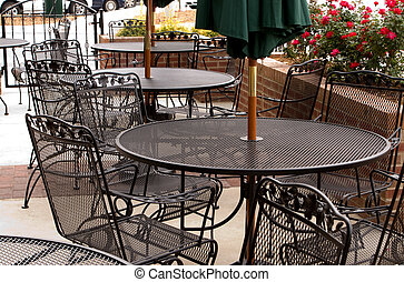 Outdoor Cafe - Tables set up outside of a local cafe