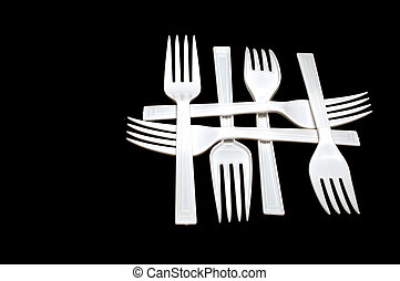 Plastic Forks - A collection of plastic forks in a pattern