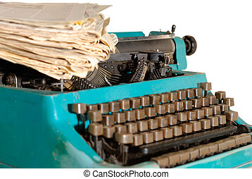 Typewriter And Newspapers - Old typewriter with stack of...