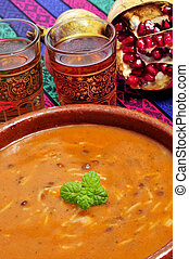 bowl with harira, the traditional Berber soup of Morocco -...