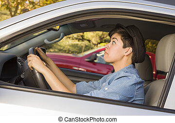 Stressed Mixed Race Woman Driving in Car and Traffic - Very...