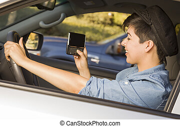 Mixed Race Woman Texting and Driving - Mixed Race Woman with...