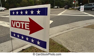 vote sign on the street - A sign pointing the way to a...