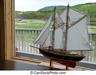 Model Ship - Stock photo of a model ship with large sails in...