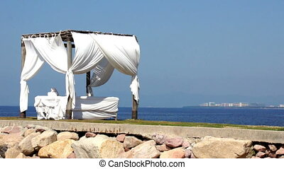 Massage Tent - A tent for massages near the ocean. Location:...