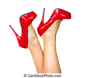 Woman legs with a red sexy shoes Isolated on white...