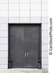 Entrance black door - Black door on modern commercial...