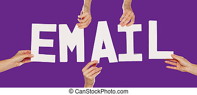 Female hands holding letters EMAIL - Female hands holding...