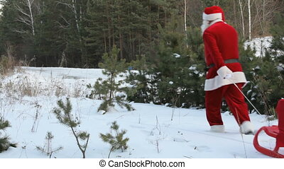 Santa losing sack - Santa pulling sled with sack full of...