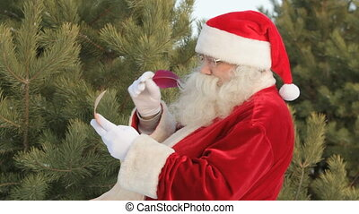 Santa writing letter - Santa writing a Christmas letter to...